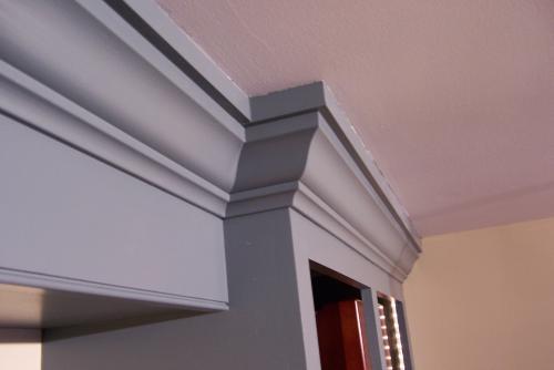 Crown molding detail for home office bookshelf.