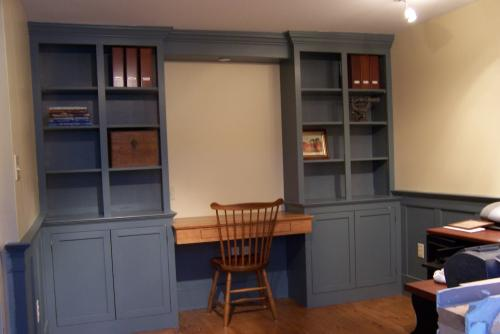 Custom made home office with bookshelves,desk, and cabinets.